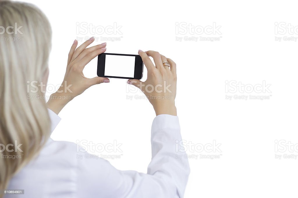 Woman taking photo with mobile phone stock photo