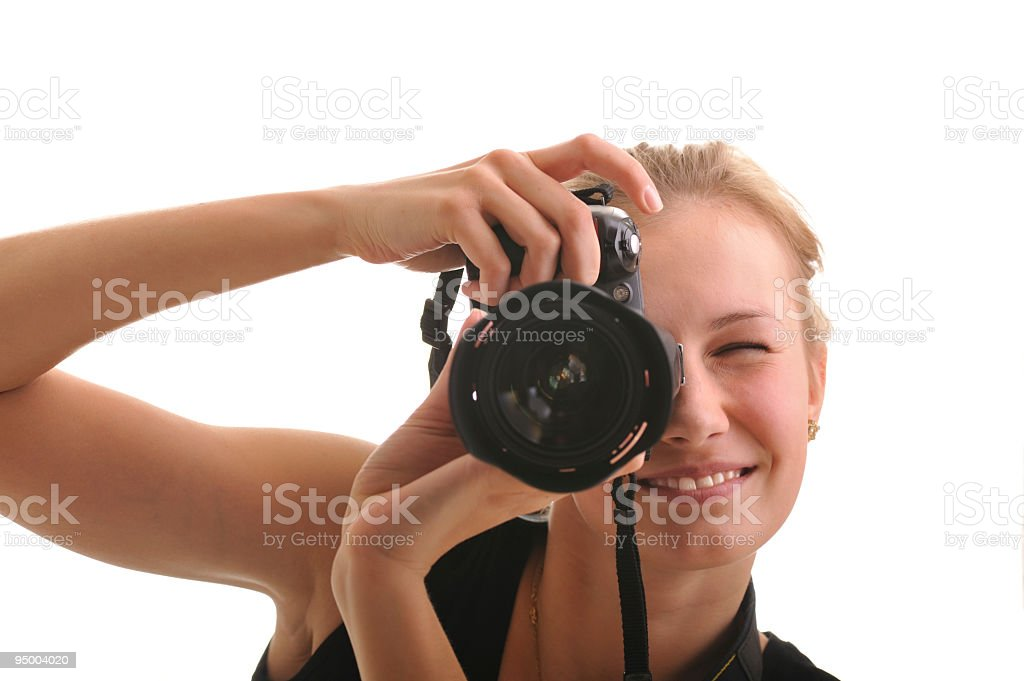 Woman taking photographs with a good camera stock photo