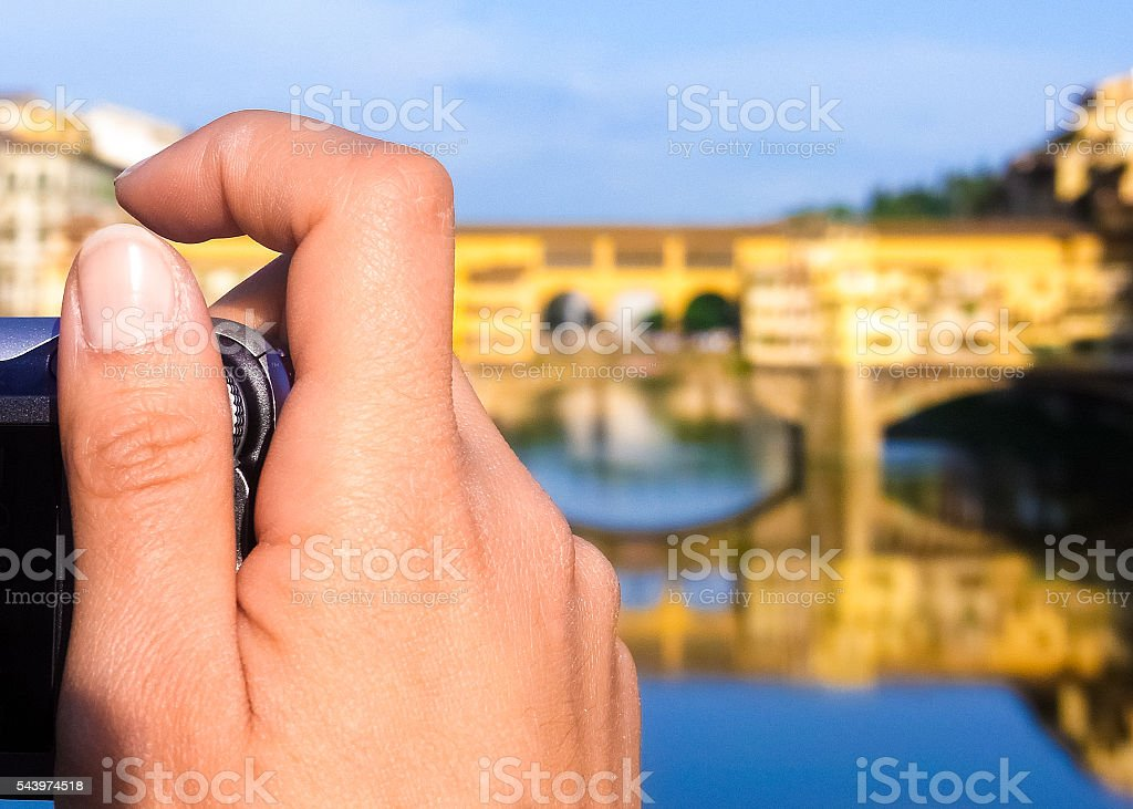 Woman taking picture of the 'Ponte Vecchio' in Florence stock photo