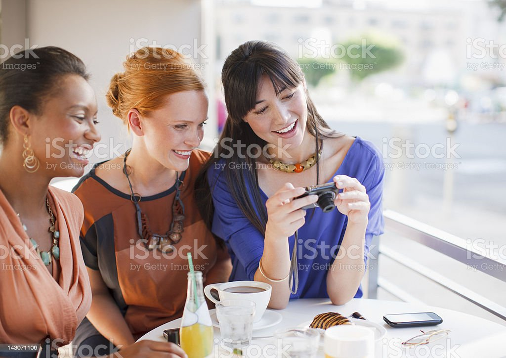 Woman taking pictures of food in cafe stock photo