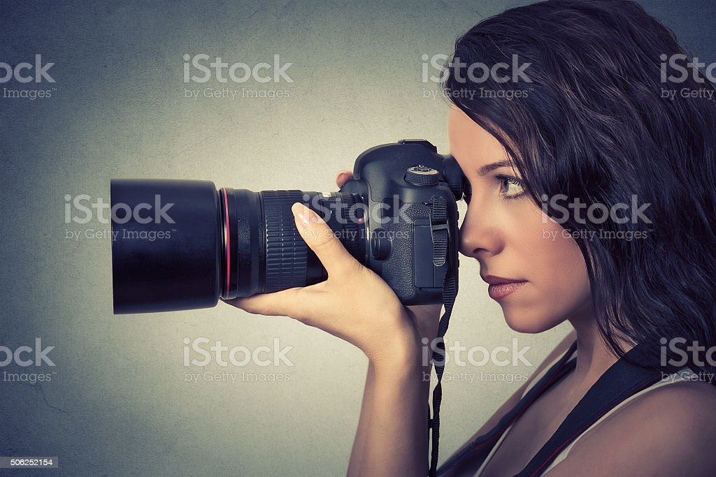 woman taking pictures with professional camera stock photo