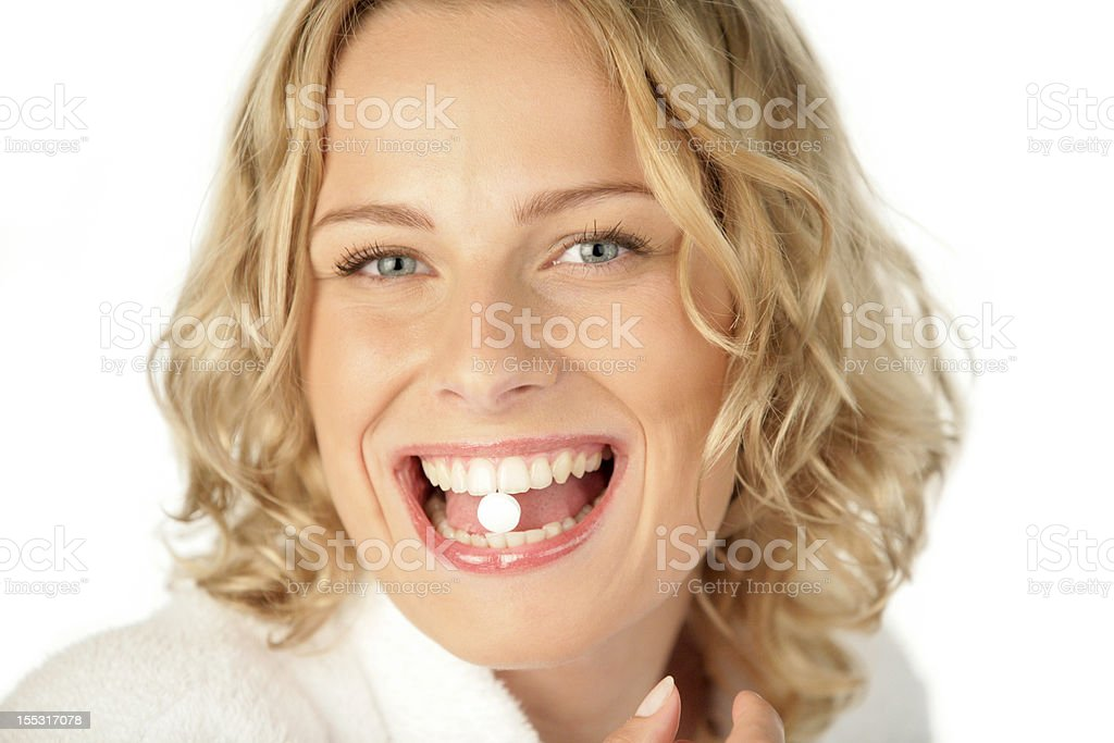 Woman taking pill royalty-free stock photo