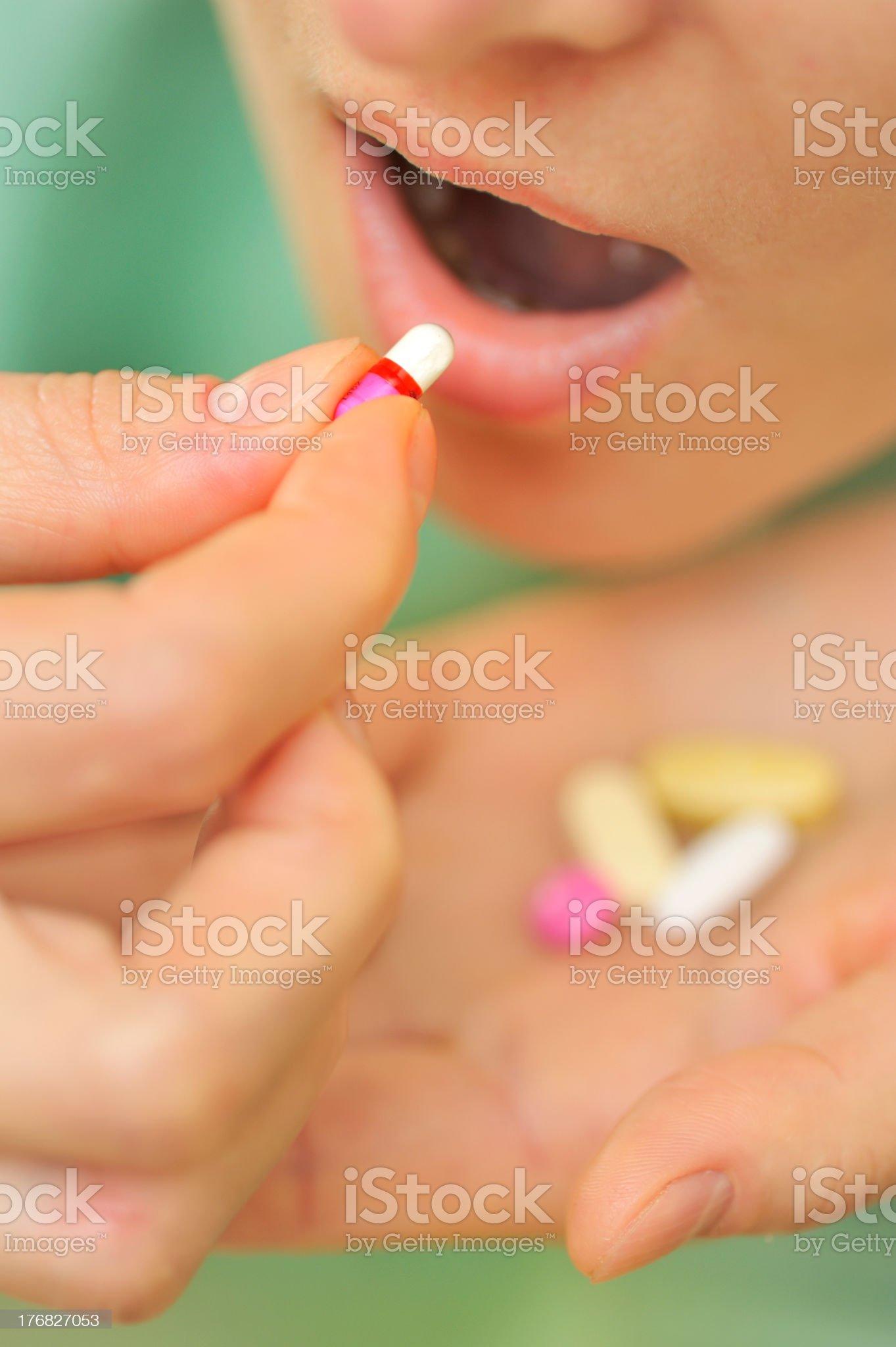 Woman taking pills royalty-free stock photo