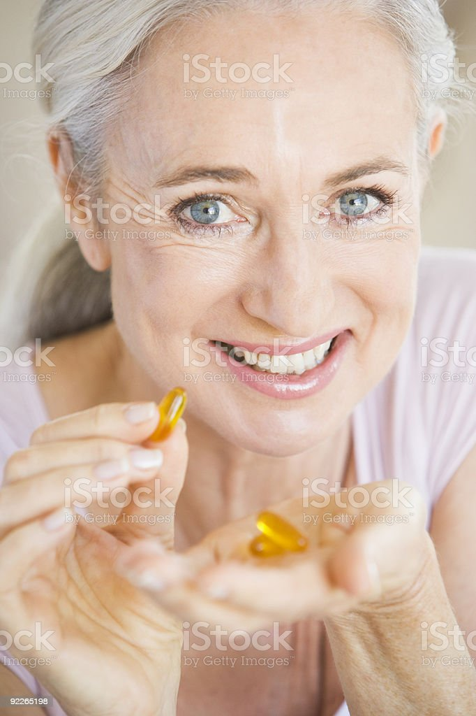 Woman Taking Pills royalty-free stock photo