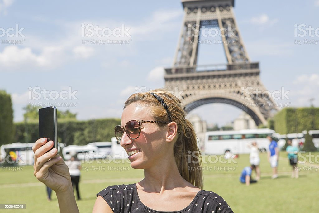 Woman taking selfie in Paris with phone royalty-free stock photo