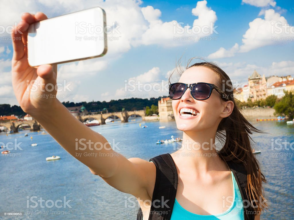 Woman taking selfie stock photo