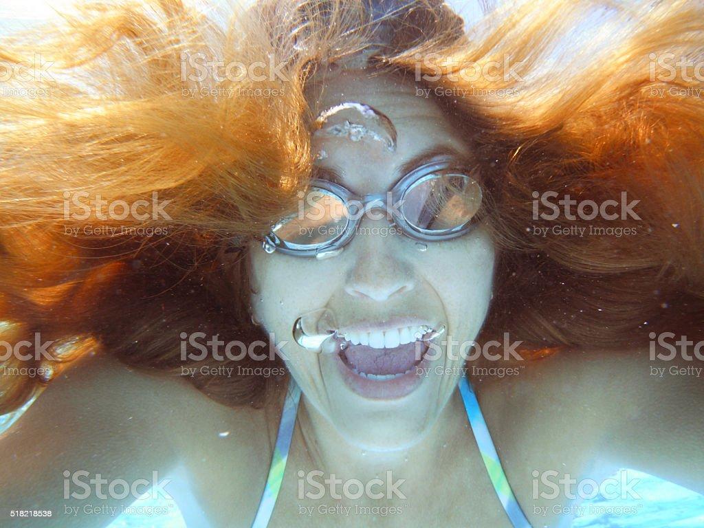 Woman Taking Silly Underwater Selfie stock photo