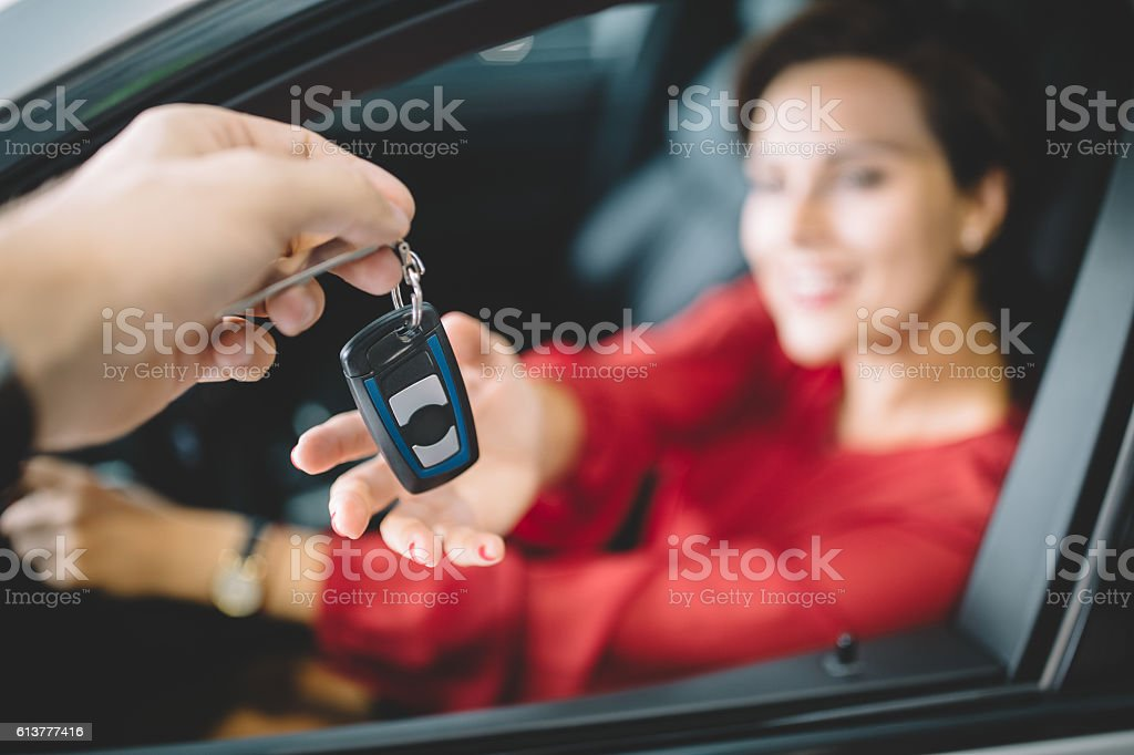 Woman taking the new car keys stock photo