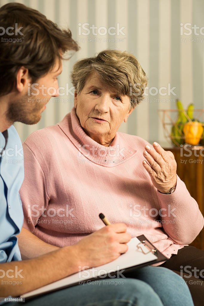 Woman talking about health problems stock photo