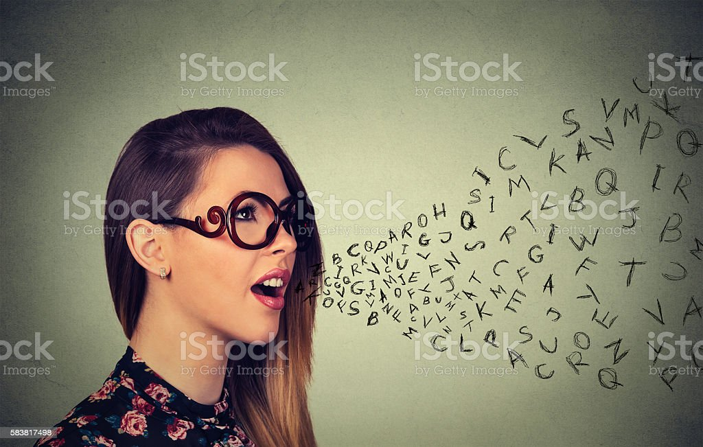 Woman talking alphabet letters coming out of mouth stock photo
