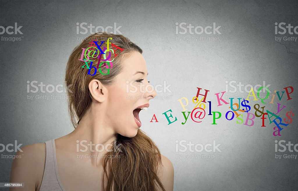 woman talking alphabet letters in her head coming out mouth stock photo
