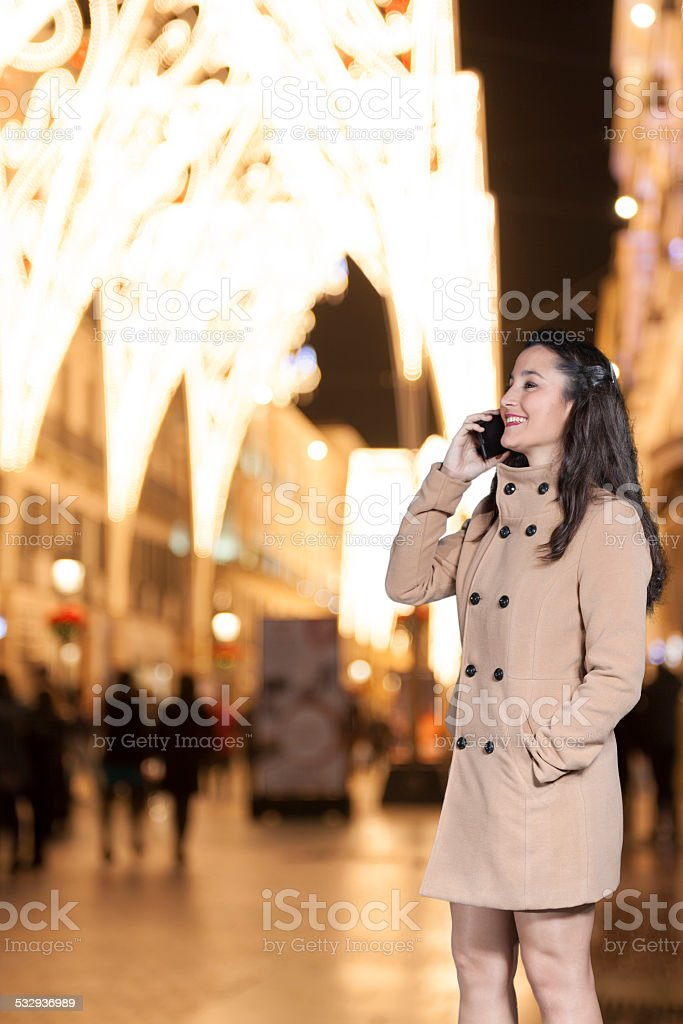 Woman talking by phone stock photo