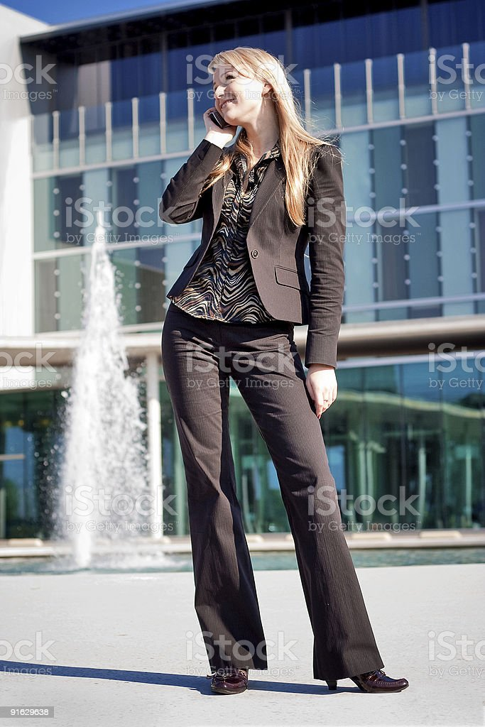 Woman talking on a phone royalty-free stock photo