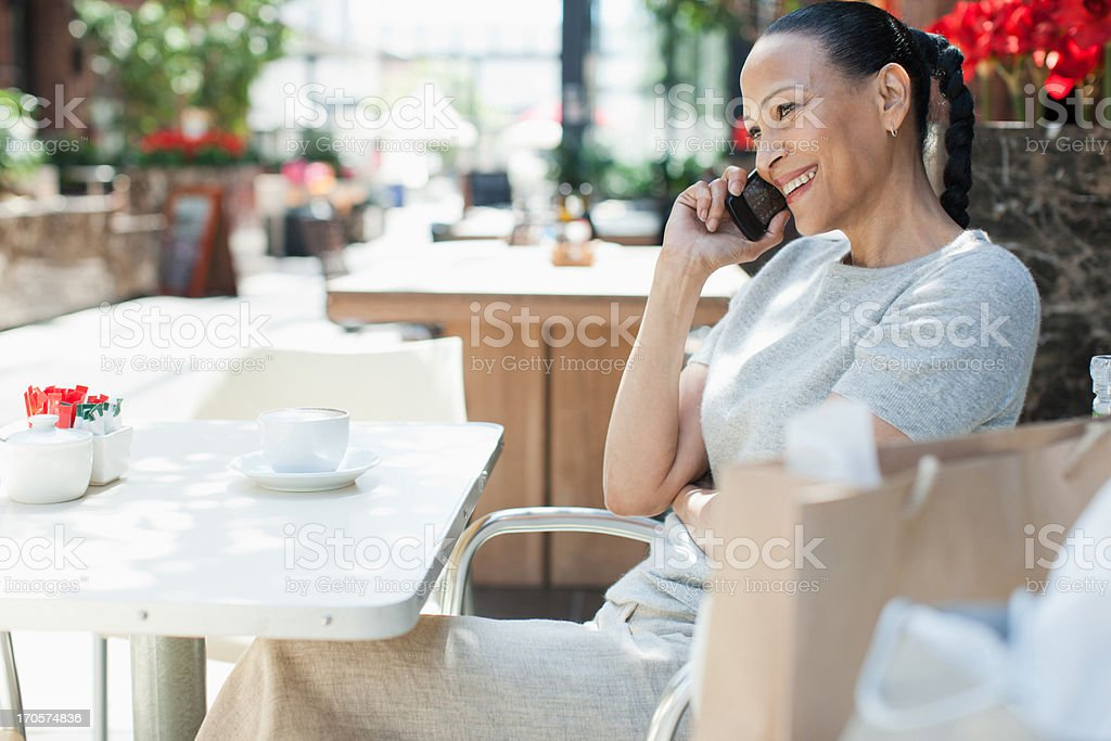 Woman talking on cell phone at cafe royalty-free stock photo