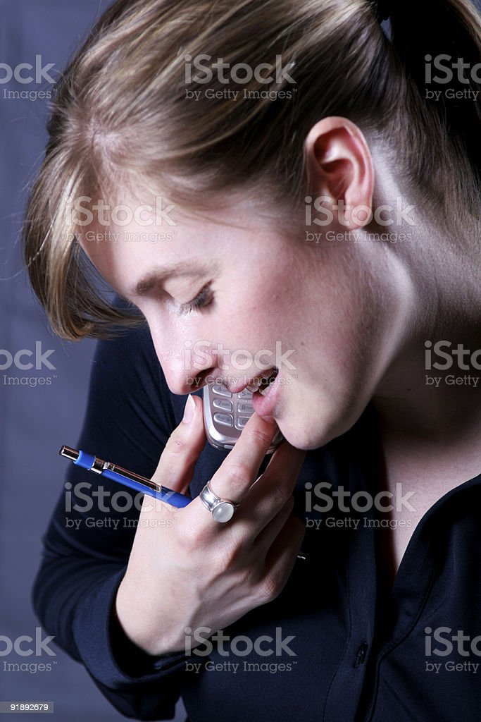 Woman talking on cell phone. stock photo