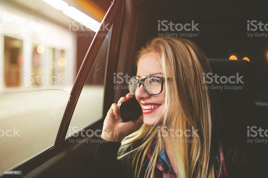 Woman talking on cellphone while traveling in the car stock photo