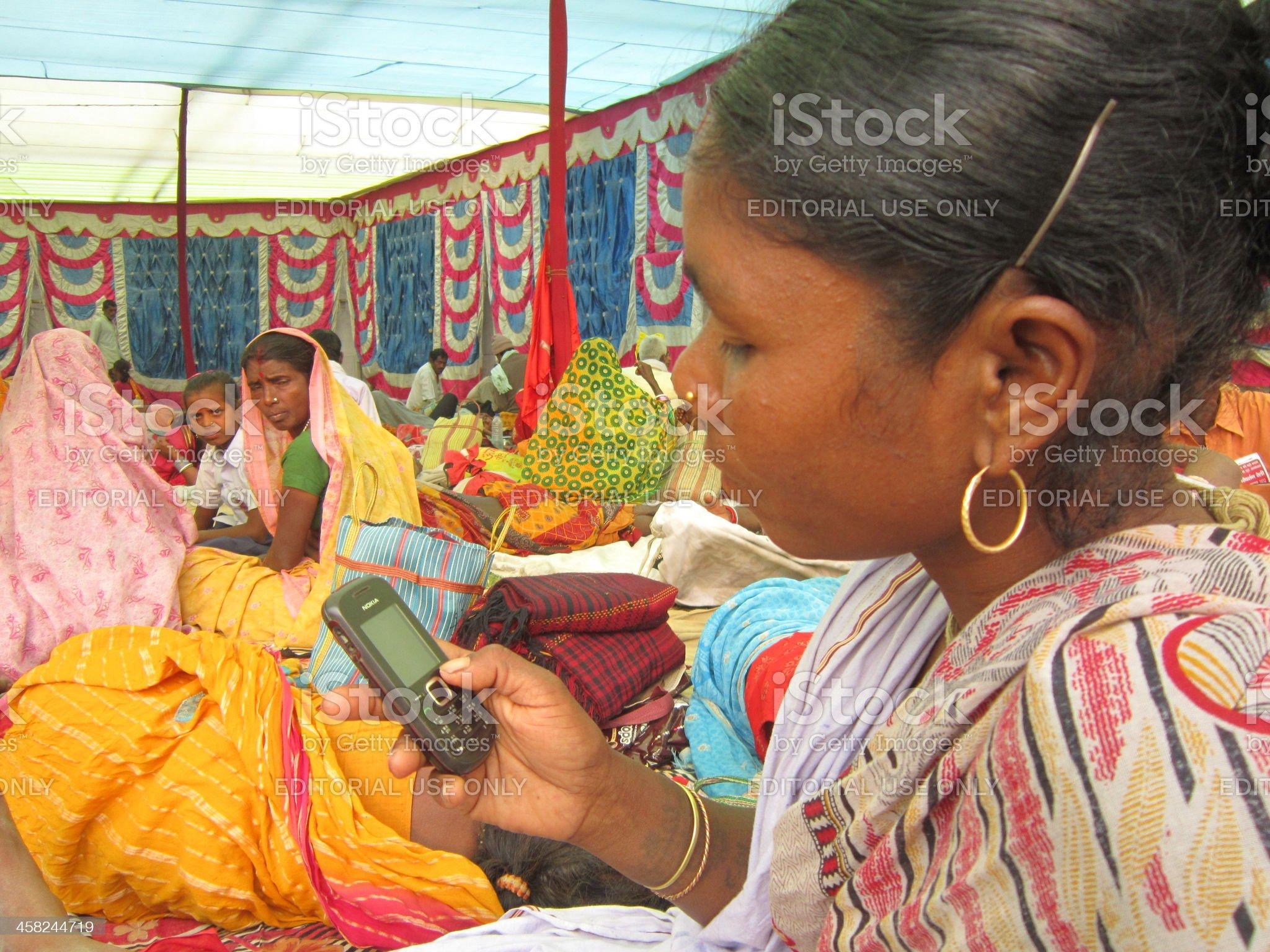 Woman talking on mobile at the venue of Parivartan Rally. royalty-free stock photo