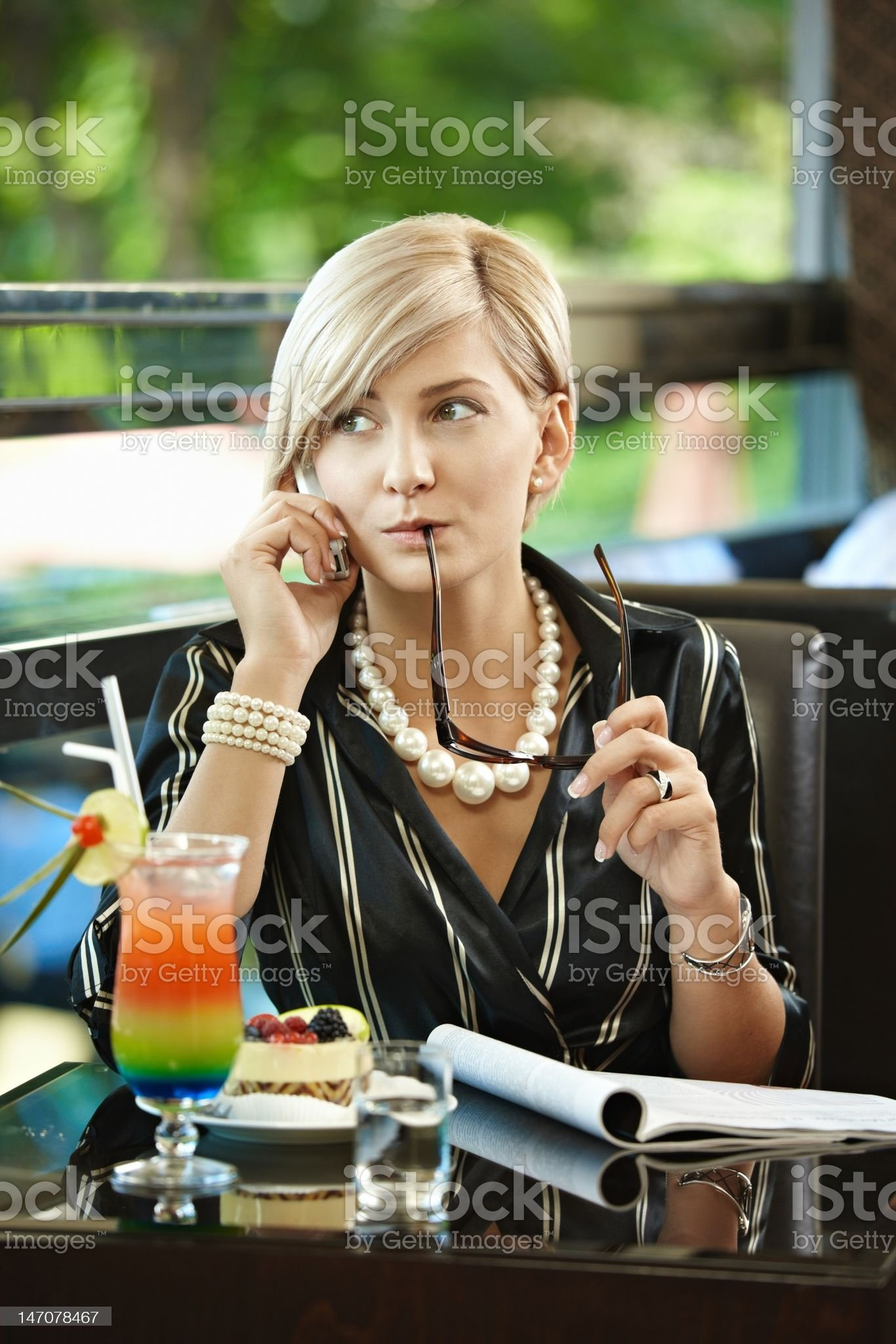 Woman talking on mobile in cafe royalty-free stock photo