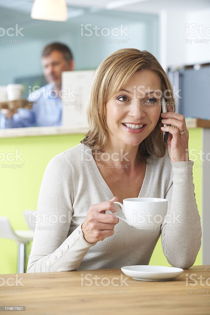 Woman Talking On Mobile Phone In Coffee Shop royalty-free stock photo