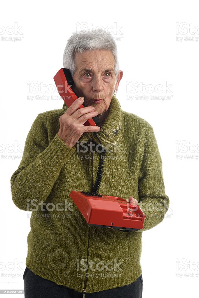 woman talking on old phone stock photo
