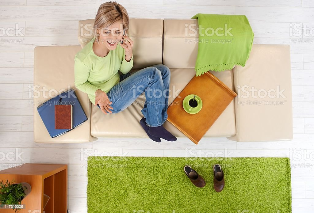 Woman talking on phone at home royalty-free stock photo