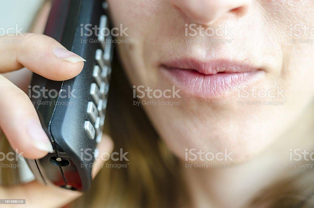 Woman talking on telephone royalty-free stock photo
