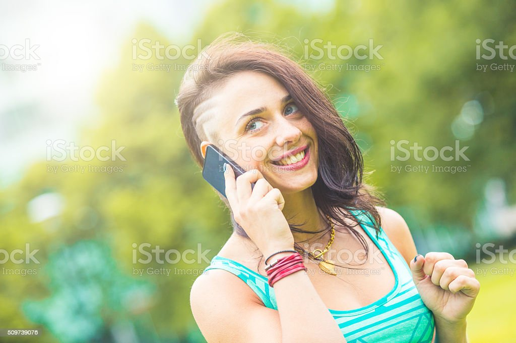 Woman talking on the phone and looking away from camera stock photo