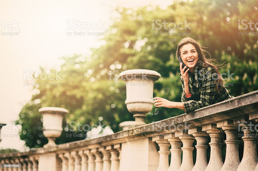 Woman talking on the phone in Paris stock photo