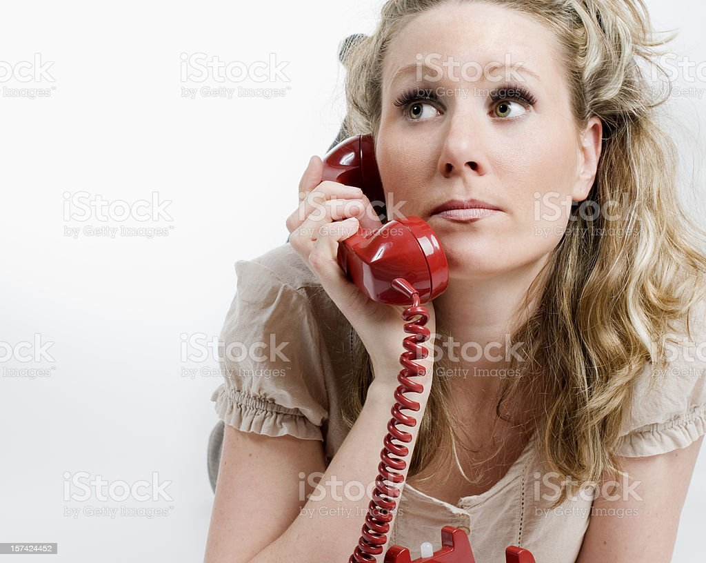 Woman Talking on Vintage Red Phone stock photo