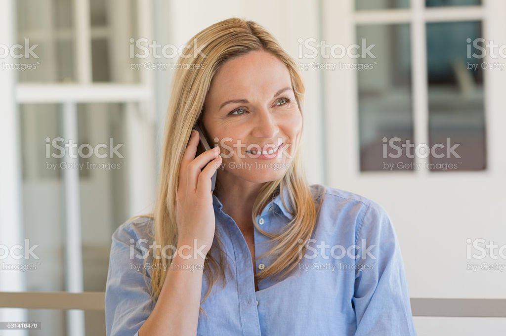 Woman talking over phone stock photo
