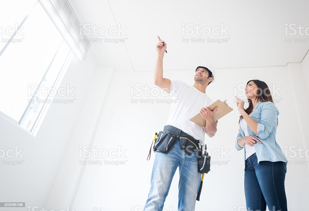 Woman talking to a construction worker stock photo