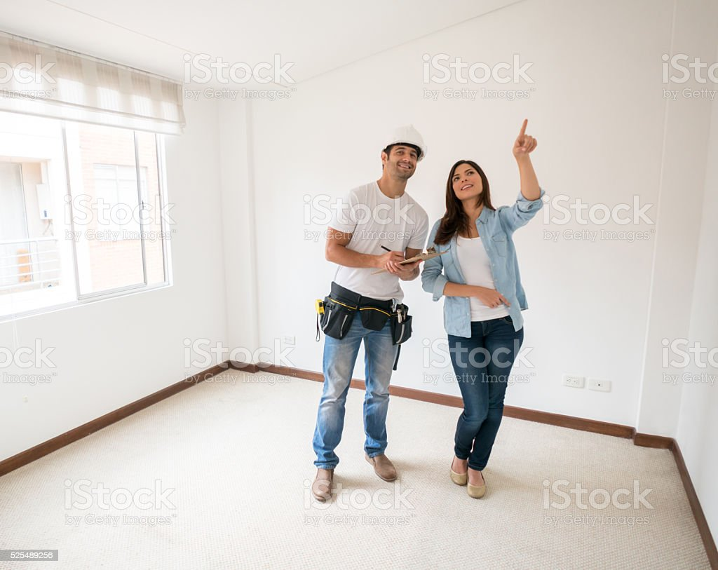Woman talking to construction worker about a housing project stock photo