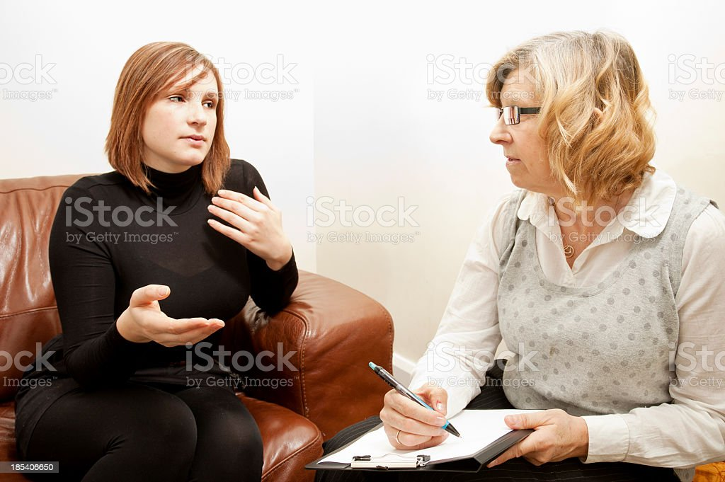 Woman talking to her female counsellor royalty-free stock photo