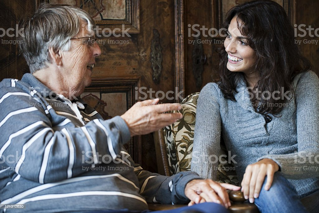 Woman talking to her grandmother royalty-free stock photo