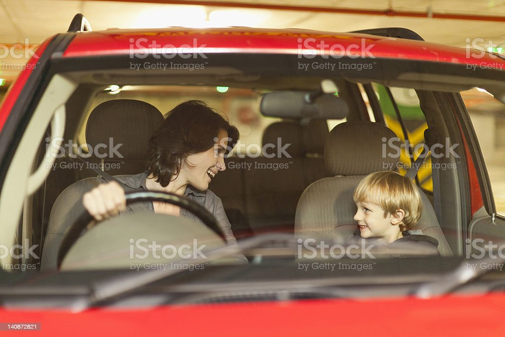 Woman talking to son while driving stock photo