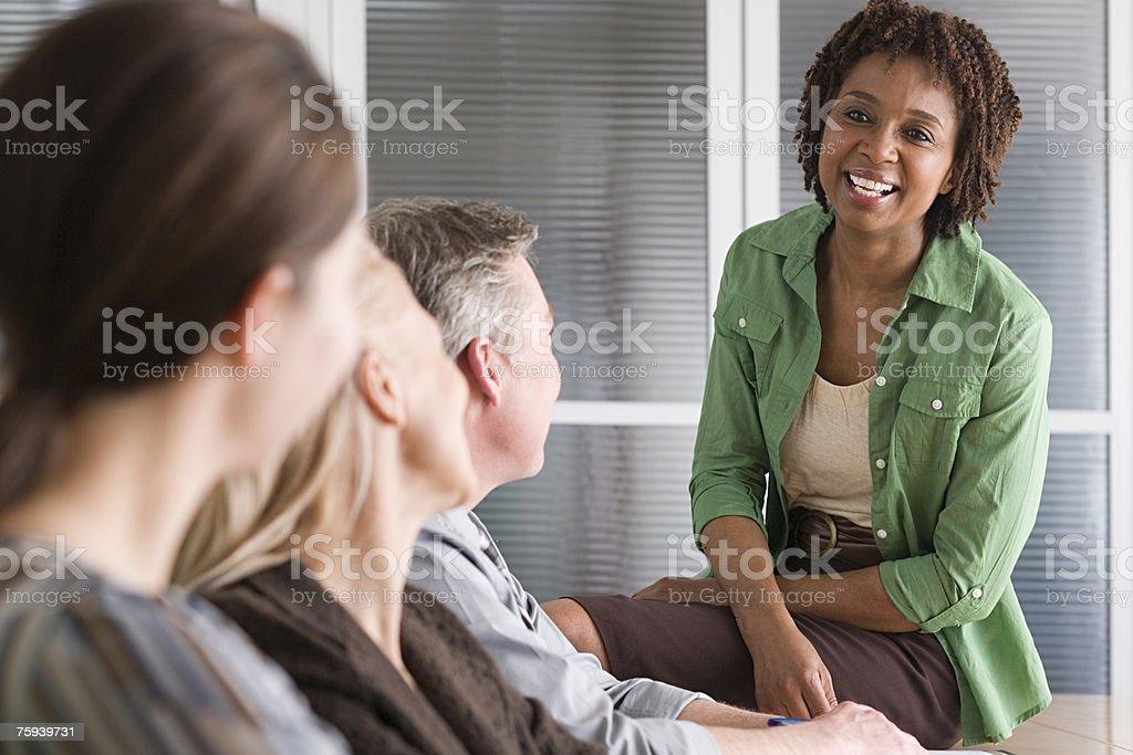 Woman talking to team stock photo