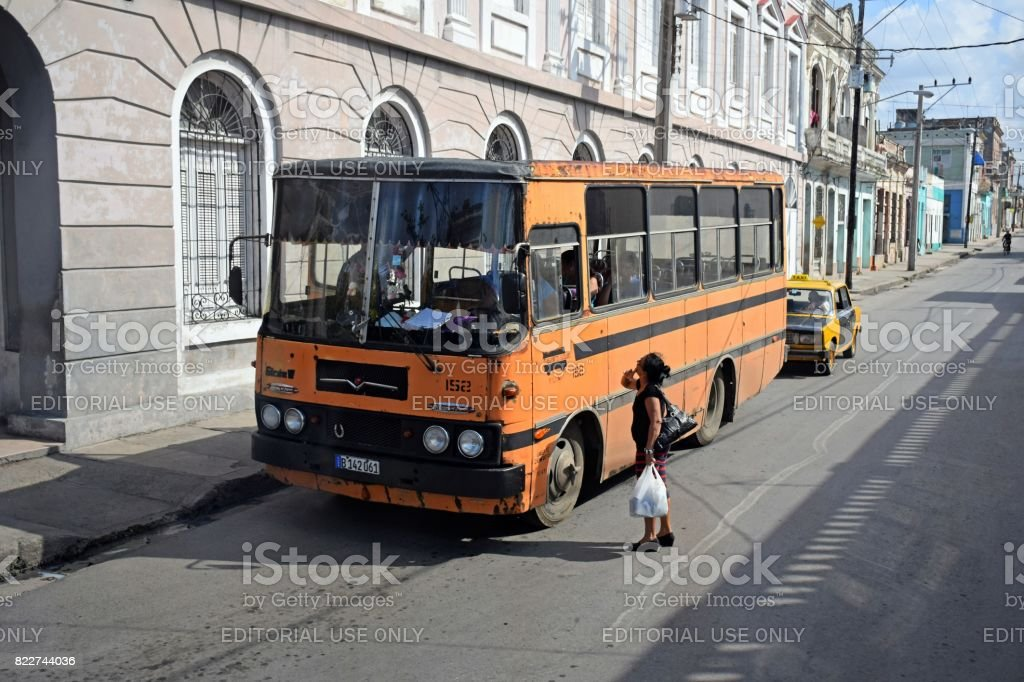 Woman talking with a bus driver on the street stock photo