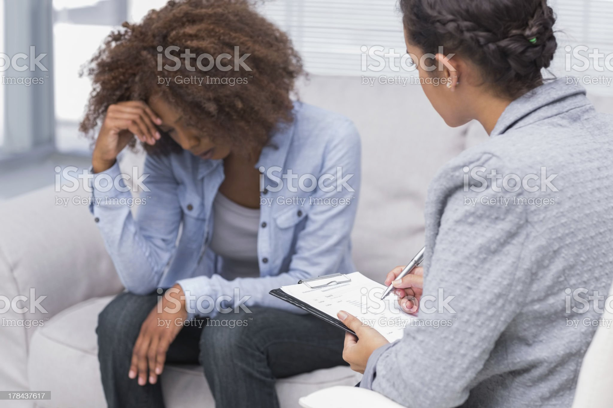 Woman talking with a therapist royalty-free stock photo