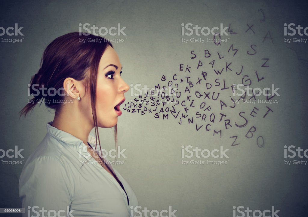 Woman talking with alphabet letters coming out of her mouth. stock photo