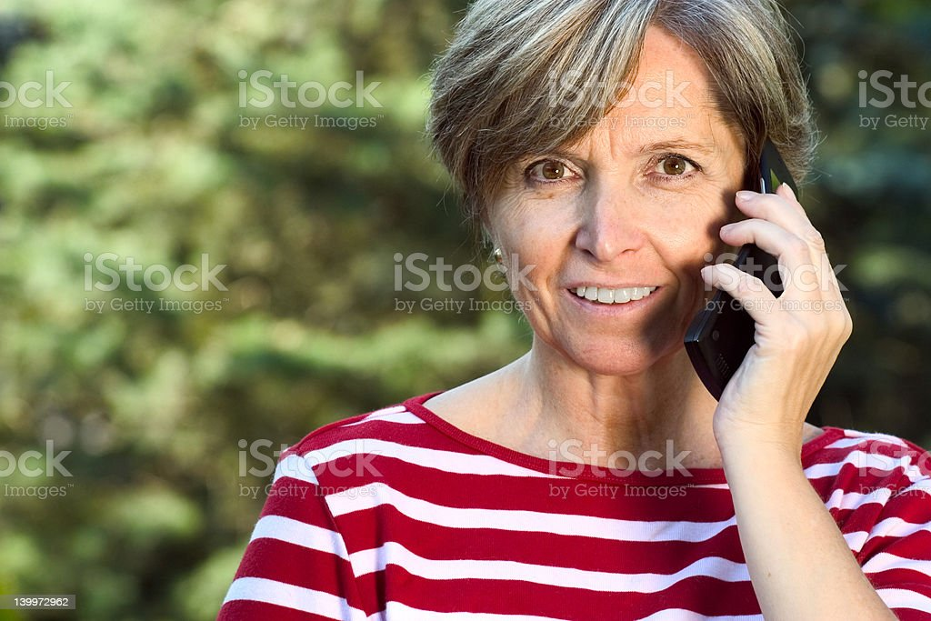 Woman talks on the phone royalty-free stock photo