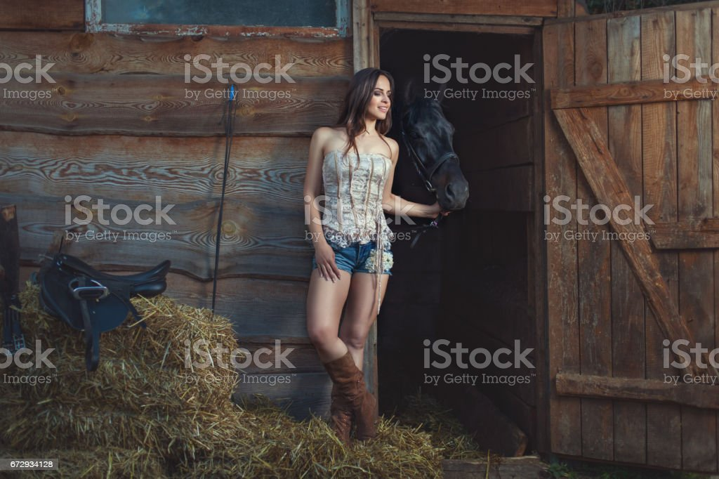 Woman talks to a horse. stock photo