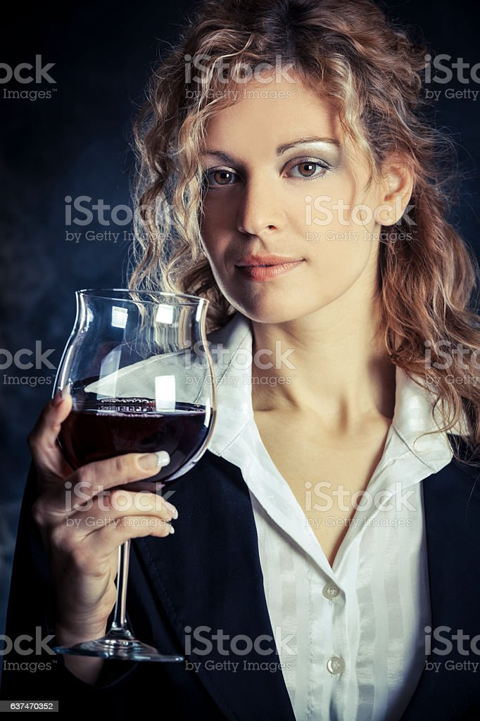 Woman tasting red wine stock photo