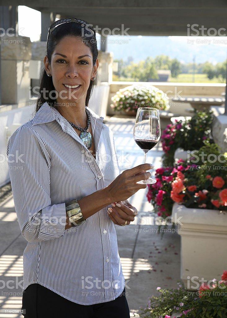 Woman tasting wine royalty-free stock photo