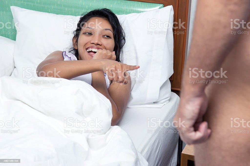 Woman taunts naked man stock photo