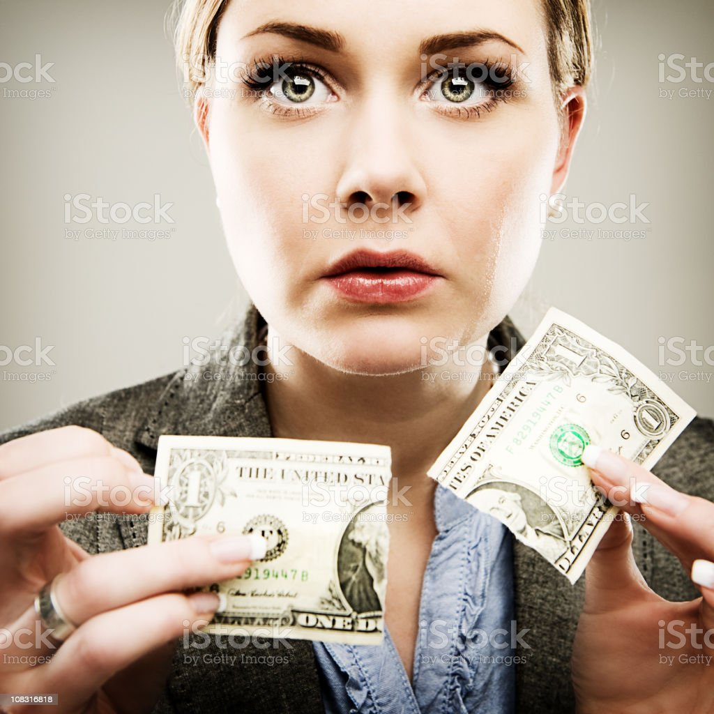 Woman tearing apart a dollar royalty-free stock photo