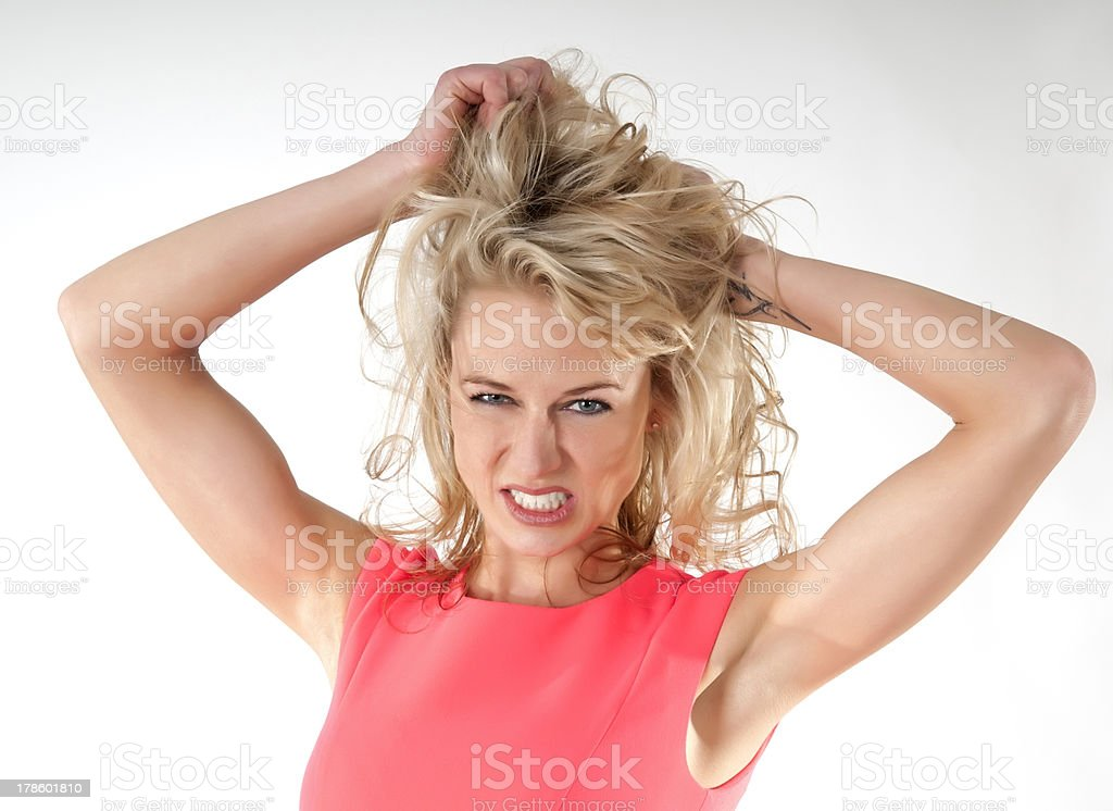 woman tearing her hair stock photo