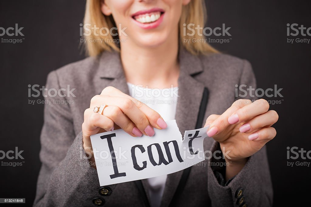 Woman tearing up ' I Can't ' sign stock photo