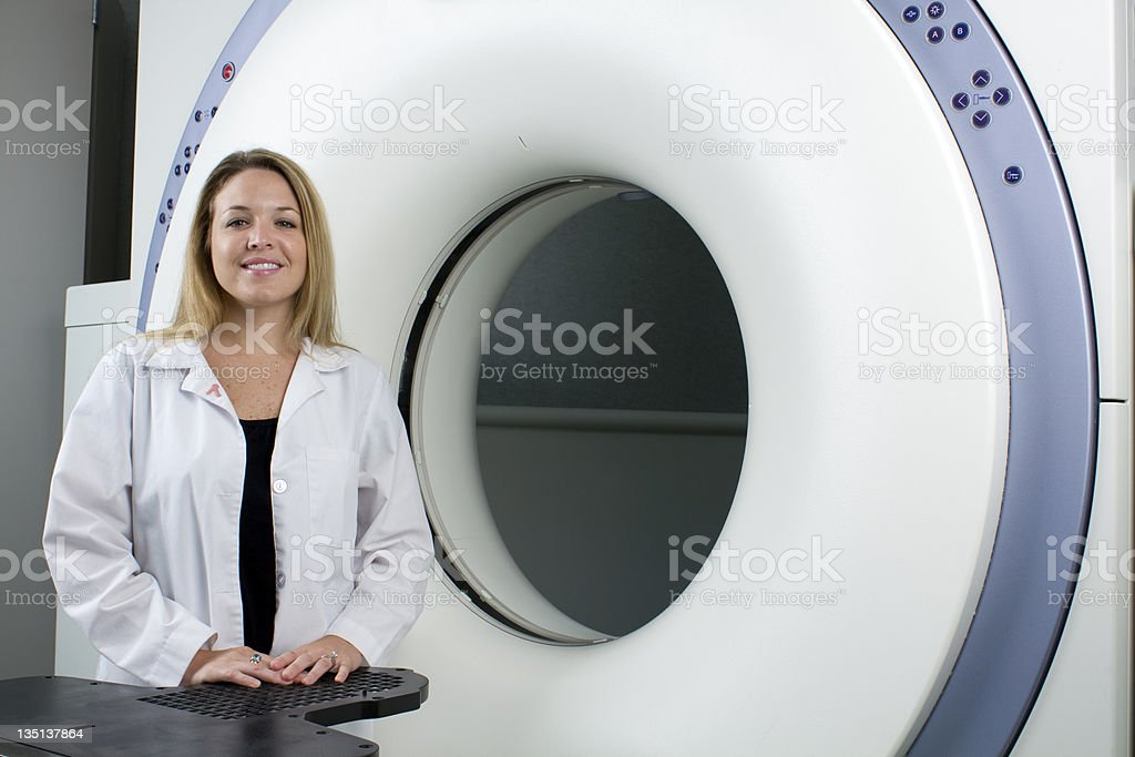 Woman Technologist with Medical Scanner royalty-free stock photo