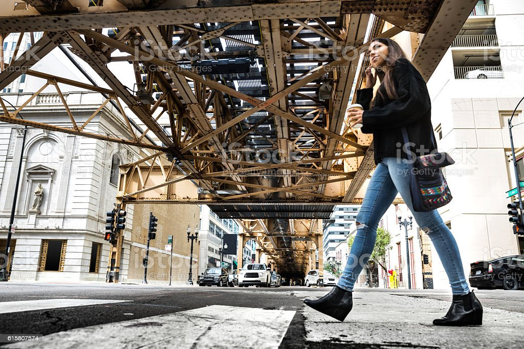 Woman teen in Chicago downtown having fun waiting for friends stock photo