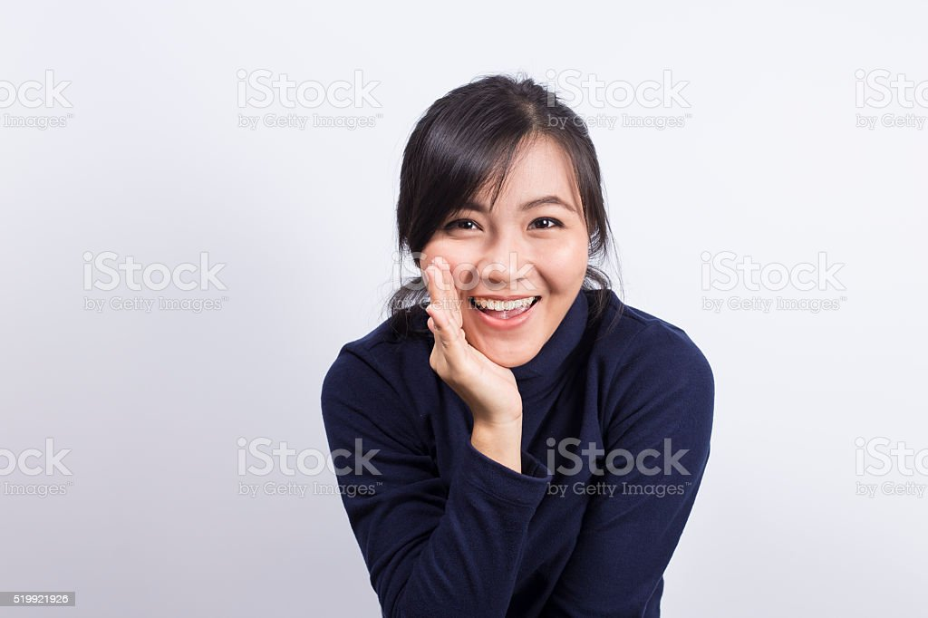 Woman telling a secret stock photo